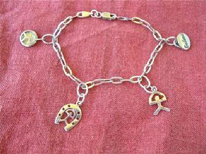 Charm bracelet with Indalos